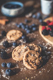 Chocolate cookies. On the kitchen, cooking with forest berries,  chocolate, biscuits, and cookies. On the table, waiting for breakfest Royalty Free Stock Photo