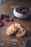 Chocolate cookies. On the kitchen, cooking with forest berries,  chocolate, biscuits, and cookies. On the table, waiting for breakfest Stock Image