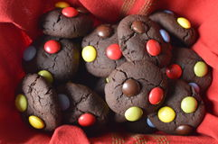 Chocolate cookies with m&m. Homemade, round chocolate cookies with colorful candy m&m, perfect for child's day, with Chocolate chip stock image