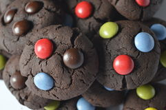 Chocolate cookies with m&m. Homemade, round chocolate cookies with colorful candy m&m, perfect for child's day, with Chocolate chip royalty free stock photos