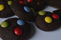 Chocolate cookies with m&m. Homemade, round chocolate cookies with colorful candy m & m, perfect for child's day, with Chocolate chip royalty free stock photos