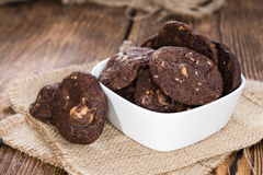 Chocolate Cookies (with macadamia nuts). Homemade chocolate Cookies (with macadamia nuts) on wooden background royalty free stock images