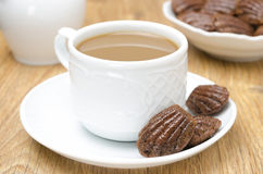 Chocolate cookies madeleine and coffee with milk Royalty Free Stock Images