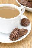 Chocolate cookies madeleine and cup of coffee with milk Stock Image