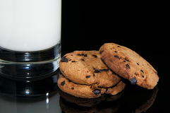 Chocolate cookies and milk Stock Images