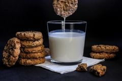 Chocolate cookies and milk, on a black background royalty free stock image