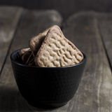 Chocolate cookies over wooden background Royalty Free Stock Photography