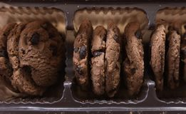 Chocolate cookies in packaging. Chocolate chip cookies top view. Stock Photo