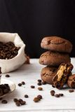 Chocolate cookies with peanut butter. On a dark background Stock Images