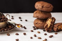 Chocolate cookies with peanut butter. On a dark background Stock Photo