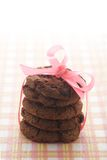 Chocolate Cookies and pink ribbon Stock Photo