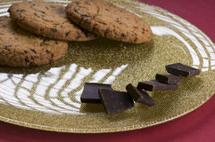 Chocolate  and cookies on a plate Stock Images