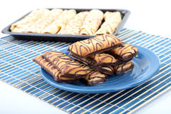 Chocolate cookies on a plate and pancakes Stock Images