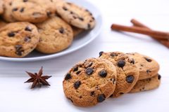Chocolate cookies on plate on white wooden background stock photo