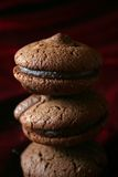 Chocolate cookies - pyramid. Image of 3 chocolate cookies on top of each other royalty free stock image