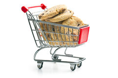 Chocolate cookies in shopping cart. The chocolate cookies in shopping cart Royalty Free Stock Photos