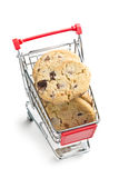 Chocolate cookies in shopping cart. The chocolate cookies in shopping cart Royalty Free Stock Images