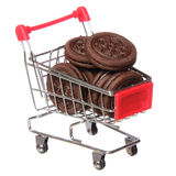 Chocolate cookies in shopping cart isolated. concept. Royalty Free Stock Images