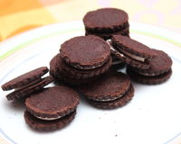 Chocolate Cookies. Some chocolate cookies filled with cream Royalty Free Stock Photo