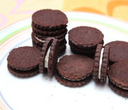 Chocolate Cookies. Some chocolate cookies filled with cream Royalty Free Stock Images