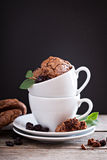 Chocolate cookies stacked in coffee cups Royalty Free Stock Photo