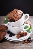 Chocolate cookies stacked in coffee cups Royalty Free Stock Image