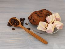 Chocolate cookies sticks with marshmallows on blue background royalty free stock image