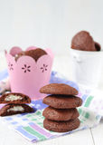 Chocolate cookies with a stuffing from mascarpone and coconut.  Stock Photography