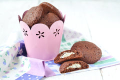 Chocolate cookies with a stuffing from mascarpone and coconut.  Stock Photos
