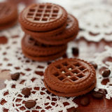 Chocolate cookies with sweet cream and coffee beans Stock Images