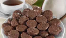 Chocolate cookies. With tea on a white plate Stock Images