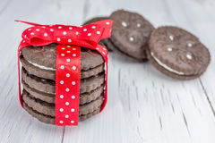 Chocolate cookies tied together with red ribbon. Closeup Stock Image