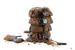 Chocolate cookies and topping. Stacked chocolate cookies, chocolate topping and cocoa powder Royalty Free Stock Photos