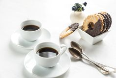 Chocolate cookies with two cups of coffee Stock Image