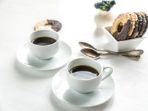 Chocolate cookies with two cups of coffee Stock Photos