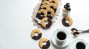 Chocolate cookies with two cups of coffee Stock Images