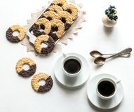 Chocolate cookies with two cups of coffee Royalty Free Stock Image