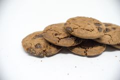 Chocolate cookies on a white background. A cookie is a baked or cooked food that is small, flat and sweet. It usually contains flour, sugar and some type of stock photography