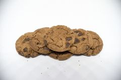 Chocolate cookies on a white background. A cookie is a baked or cooked food that is small, flat and sweet. It usually contains flour, sugar and some type of Stock Images
