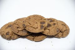 Chocolate cookies on a white background. A cookie is a baked or cooked food that is small, flat and sweet. It usually contains flour, sugar and some type of stock photos