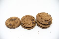 Chocolate cookies on a white background. A cookie is a baked or cooked food that is small, flat and sweet. It usually contains flour, sugar and some type of Royalty Free Stock Photos