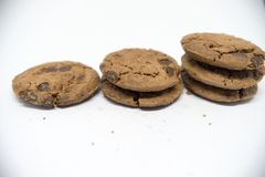 Chocolate cookies on a white background. A cookie is a baked or cooked food that is small, flat and sweet. It usually contains flour, sugar and some type of Royalty Free Stock Photography