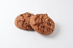 Chocolate cookies on white. Handmade tasty chocolate cookies with nuts on white Royalty Free Stock Image