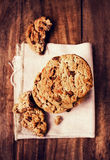Chocolate cookies on white linen napkin on wooden table. Chocola. Te chip cookies shot on white table cloth, closeup Stock Photos