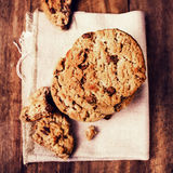 Chocolate cookies on white linen napkin on wooden table. Chocola. Te chip cookies shot on white table cloth, closeup Royalty Free Stock Photography
