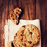 Chocolate cookies on white linen napkin on wooden table. Chocola. Te chip cookies shot on white table cloth, closeup Royalty Free Stock Images