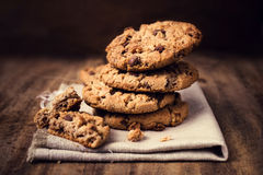 Chocolate cookies on white linen napkin on wooden table. Chocola. Te chip cookies shot on coffee colored cloth, closeup Royalty Free Stock Photos