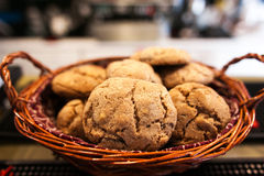 Chocolate cookies on white linen napkin on wooden table. Chocolate chip cookies shot on coffee colored cloth, closeup. royalty free stock photo
