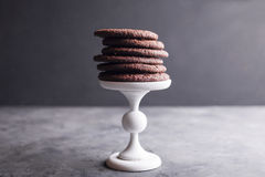 Chocolate cookies on a white pedestal Royalty Free Stock Photos