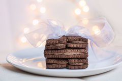 Chocolate cookies with white ribbon   on a bokeh backgroun Royalty Free Stock Photography